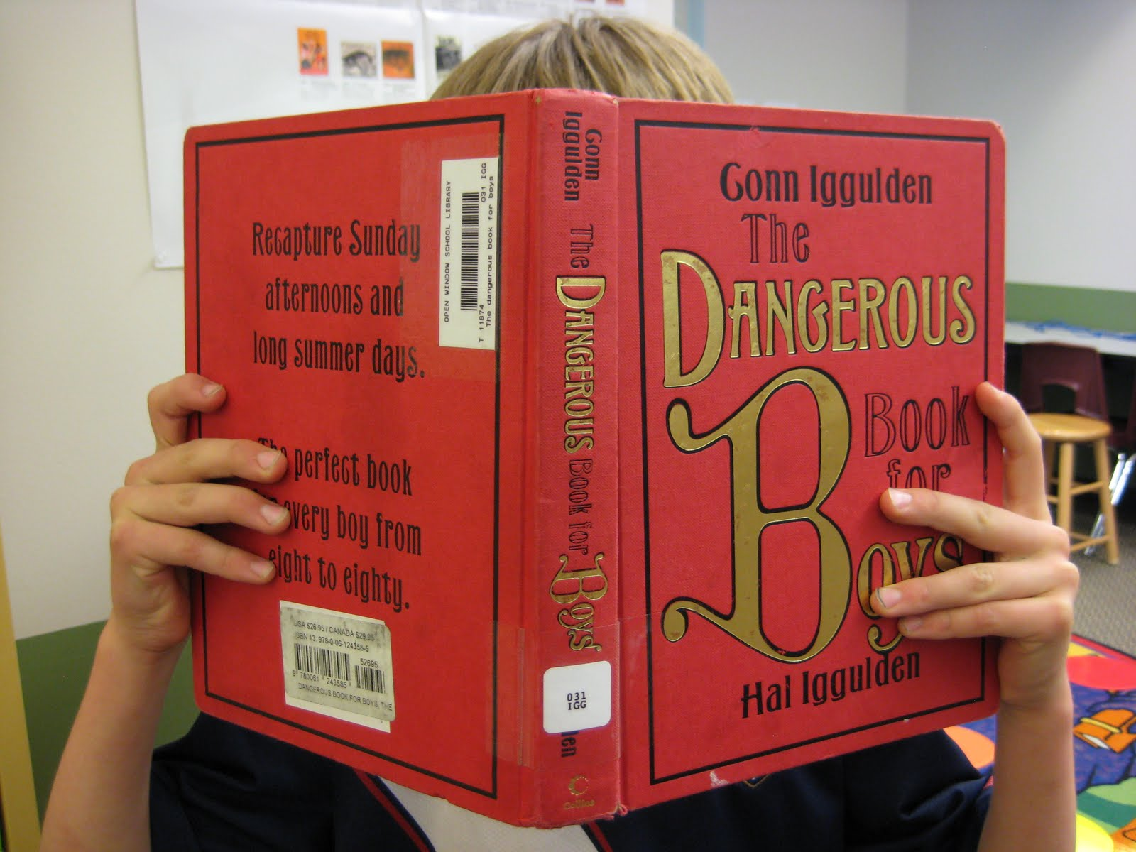 OWS 4th grader poses behind his favorite book.